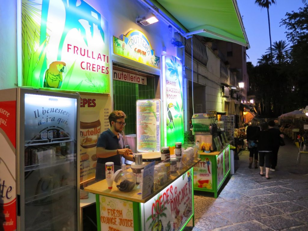 creperie and fruit juice stand in sorrento old town, italy