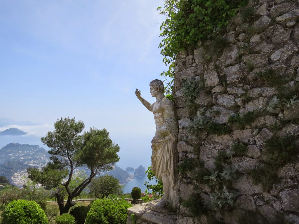 view from mount solaro on capri island with a roman style statue in the frame